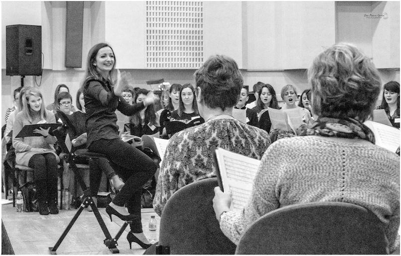 Katie Thomas Conductor conducts choir workshop